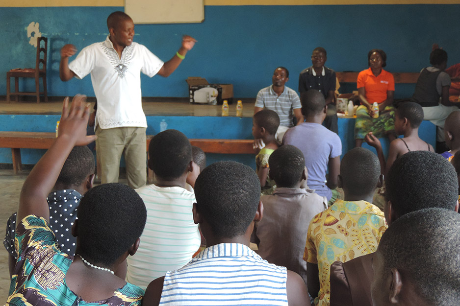 PIH nutrition officer Charles Marshal teaches at Teen HIV Club
