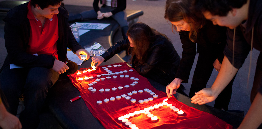 PIH Engagers light candles at a vigil in the aftermath of the Ebola crisis.