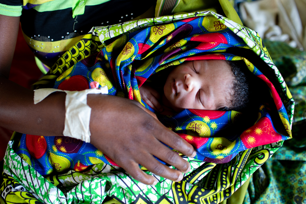 Frocy Rodgersholds her one-day-old son in the maternal waiting home at Matandani Health Centre in Malawi.