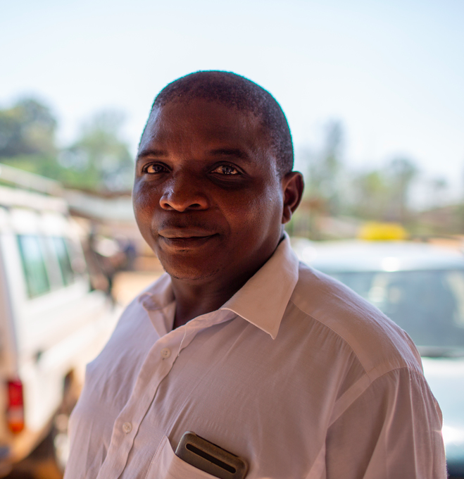 PIH transport officer Mabvuto Chifenthe in front of an emergency vehicle in Neno, Malawi.