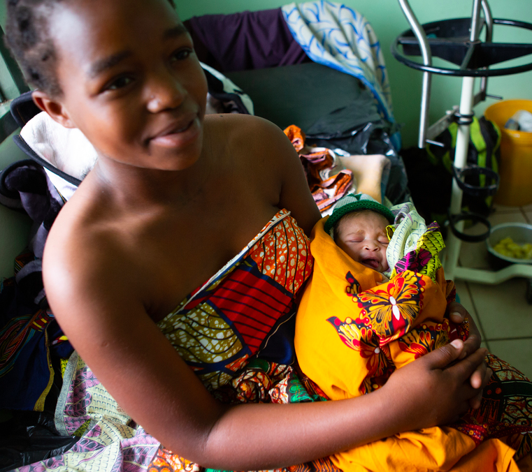 Mary Samson rests with her newborn daughter Hannah at Malawi's Neno District Hospital, where she gave birth less than 24-hours prior.