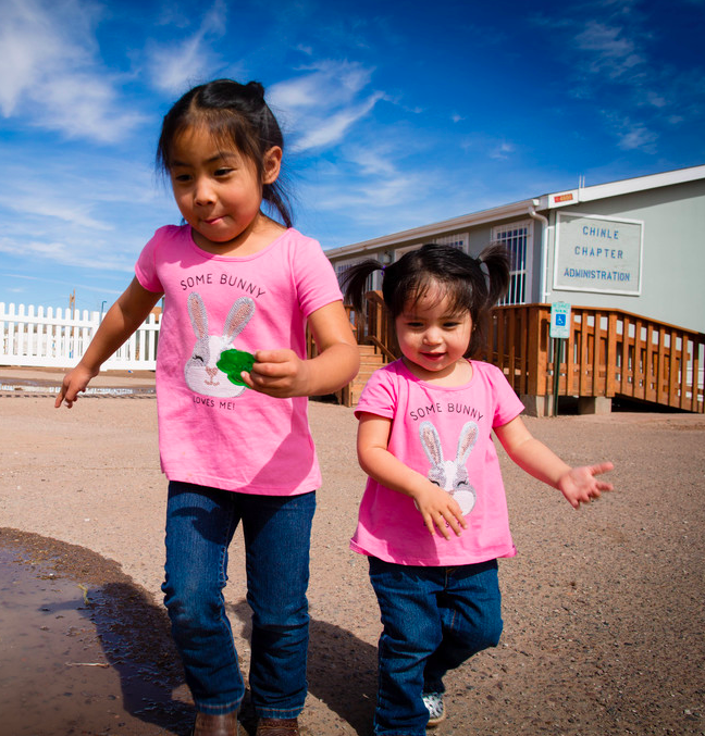 Four-year-old Nizhoni (left) plays with her sister, 2-year-old Nataznabah, receive crucial food support.