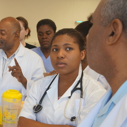 Residents listens during rounds