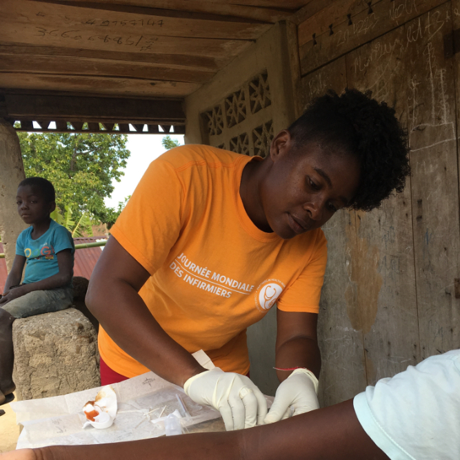 Nurse administering a long-acting reversible contraceptive implant in Haiti.