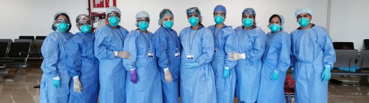 Clinicians from Socios En Salud (PIH in Peru) line up in protective gear