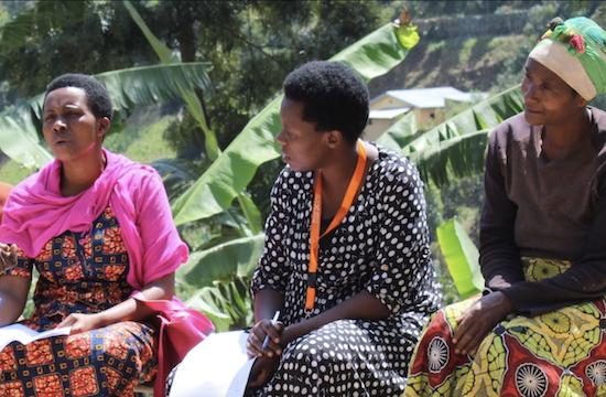 three women sitting and talking