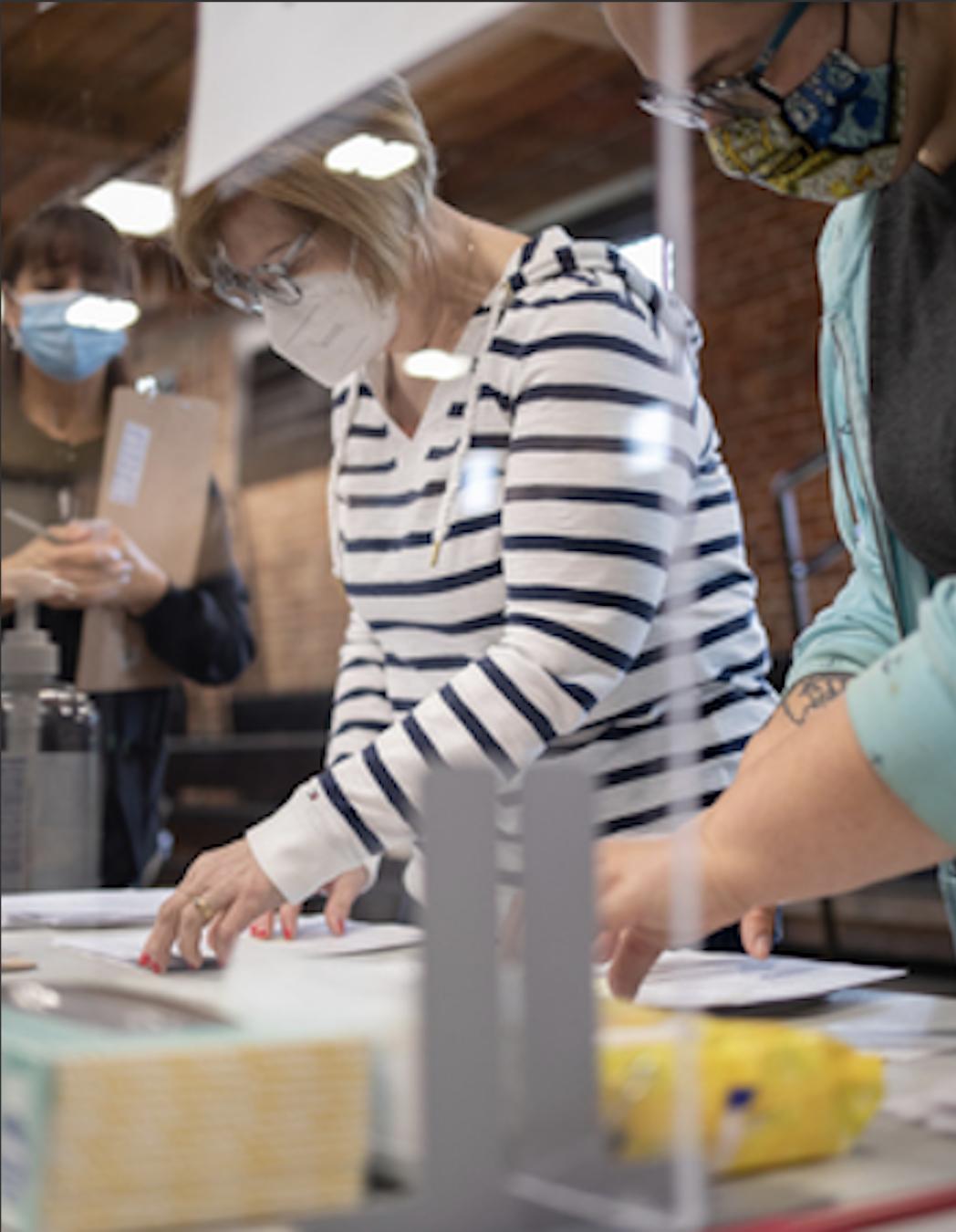 women sitting doing work