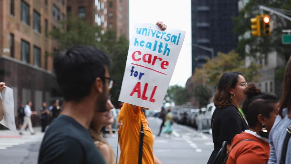 "At the United Nations General Assembly, PIH protested for ""care not coverage."""