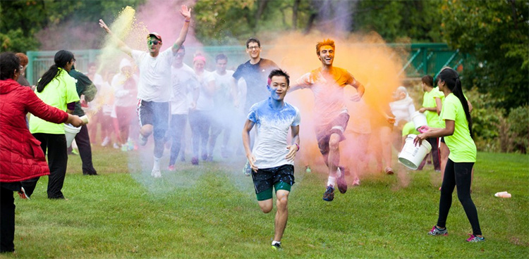 Runners are covered in colored dust as they complete the Binghamton Color Run.