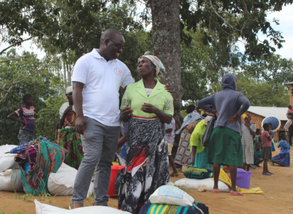 Dr. Luckson Dullie and Roda Biziwelo at a flood relief event in Neno District