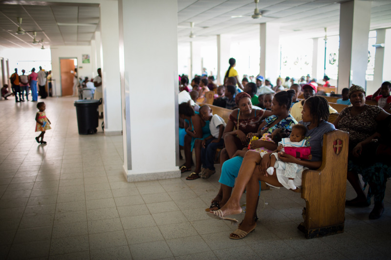 Patients wait to receive care at PIH-supported University Hospital at Mirebalais