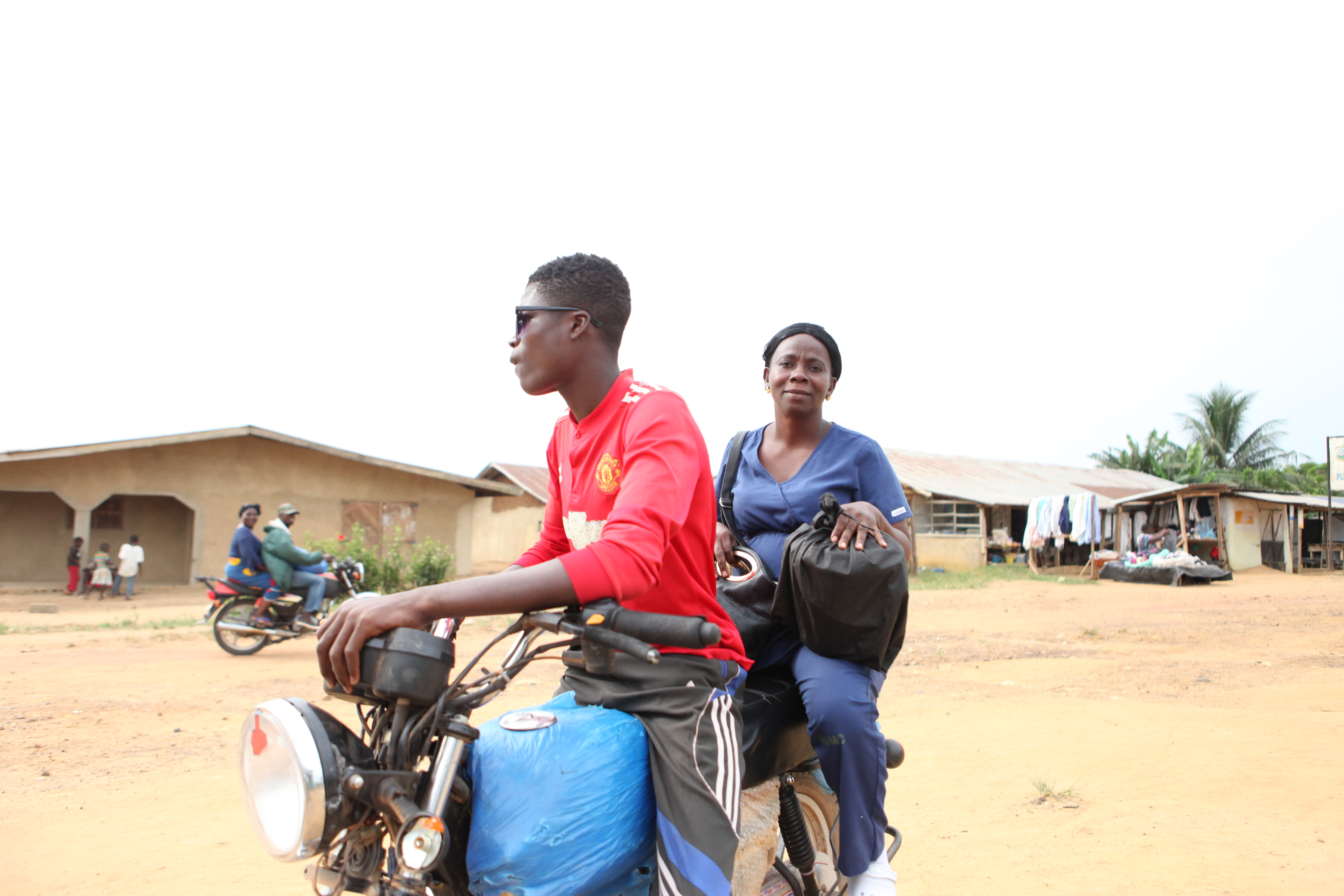 midwife arrives at Pleebo Health Center by motorcycle