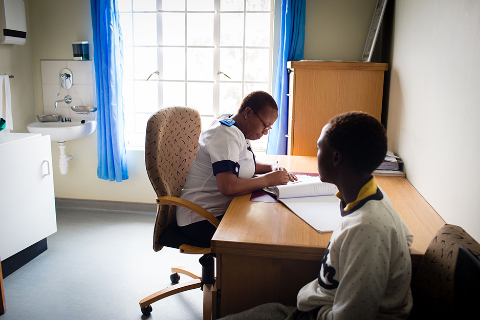 Masefako Ntjabane Liotlo, manager and lead nurse at St. Peterís Health Center in Butha-Buthe, Lesotho, examines 28-year-old Maletuka Motobe