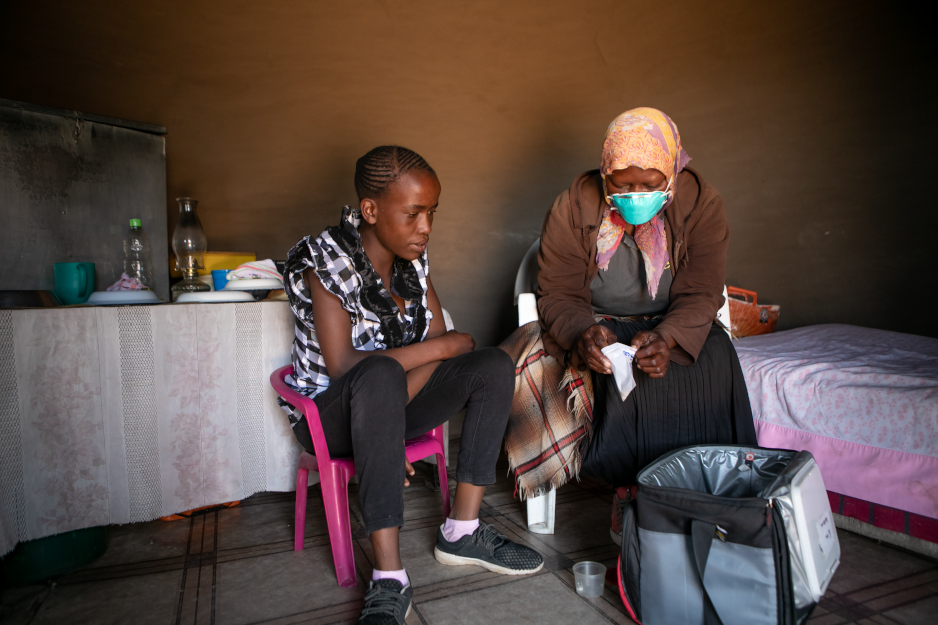 Pulane Matsuma receives TB medicine from her treatment supporter