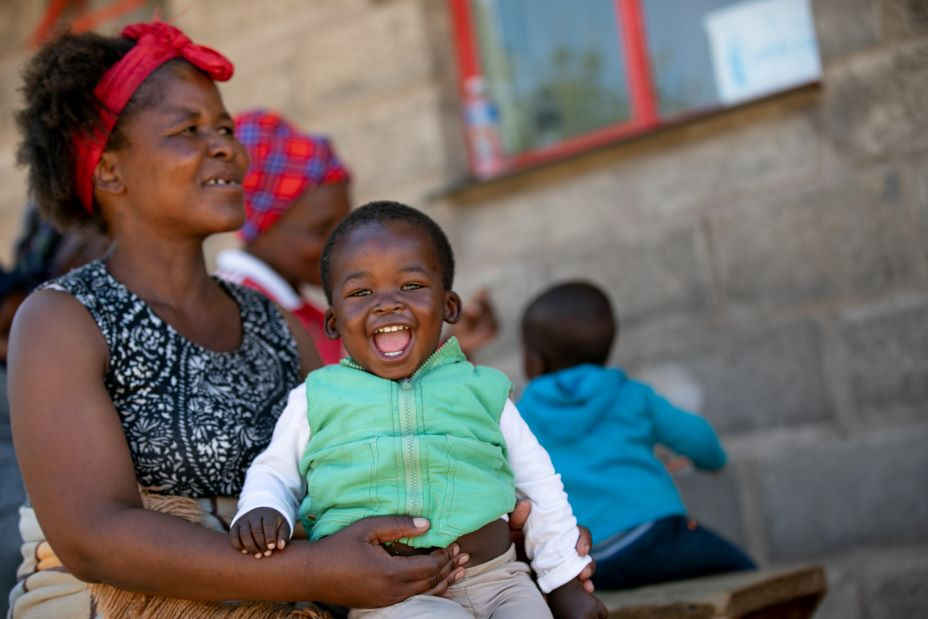 Makatiso Seeiso holds the youngest of her six children, 2-year-old Banele, at PIH-supported Nkau Health Center in Mohale's Hoek District, Lesotho.