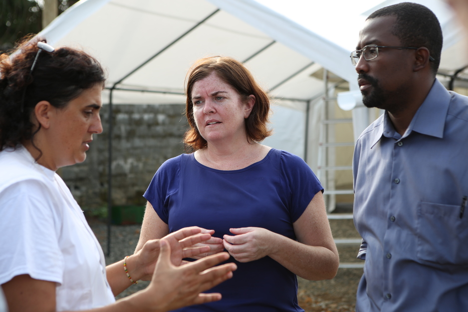 Dr. Sheila Davis consults with colleagues during the Ebola epidemic in West Africa