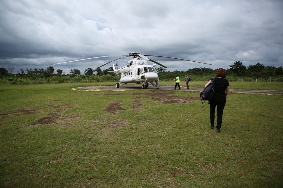 Sheila Davis walks to a helicopter during Ebola response in Liberia