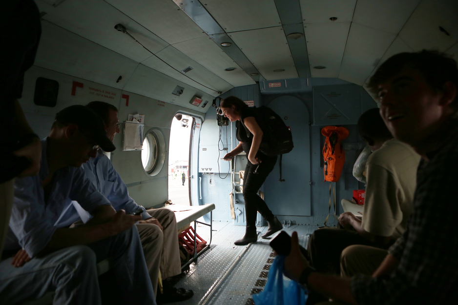 Sheila Davis departs helicopter during Ebola response in Liberia