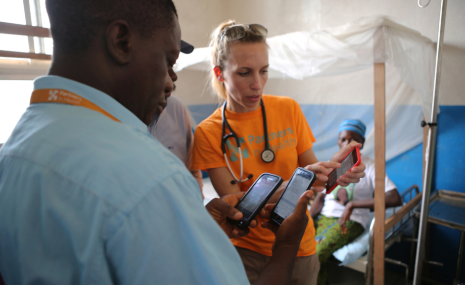 Dr. Regan Marsh works with PIH colleagues in Liberia in 2016