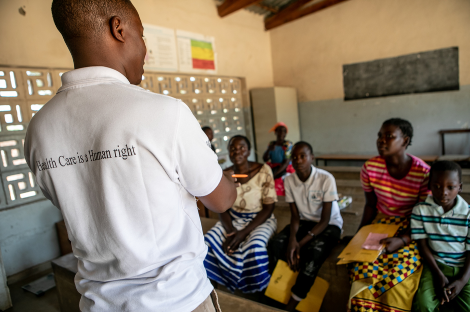 PIH's Benson Phiri welcomes families to an Advanced NCD Clinic in Neno, Malawi