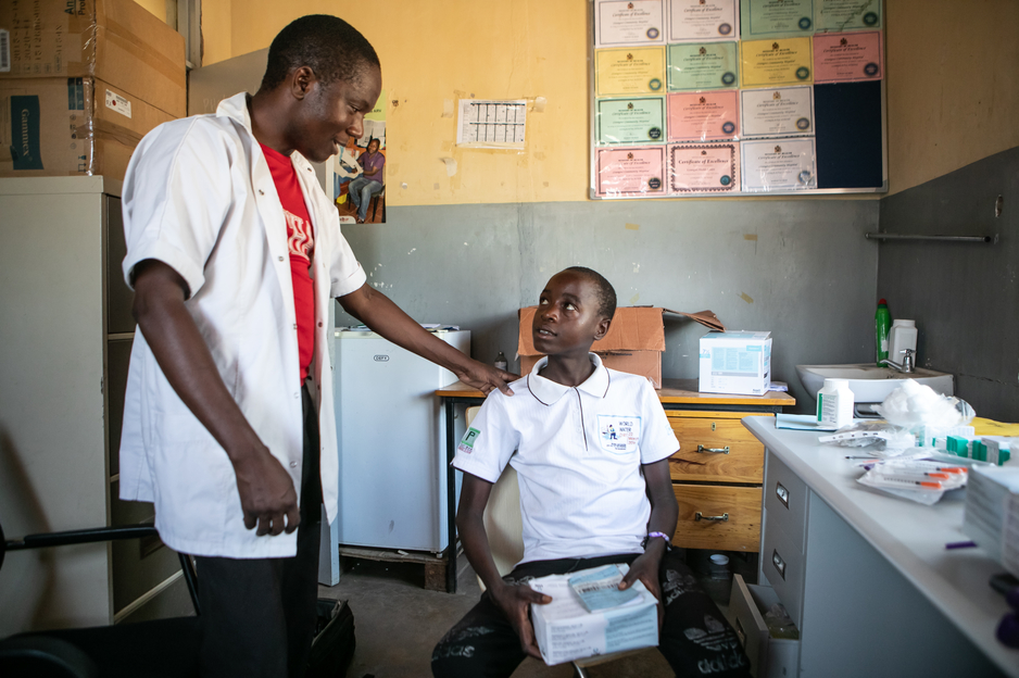 NCD nurse Victor Kaphaso advises Kerefasi about his insulin