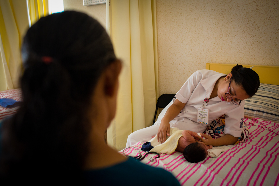 OB/GYN nurse examines a newborn at the maternal home in Chiapas, Mexico