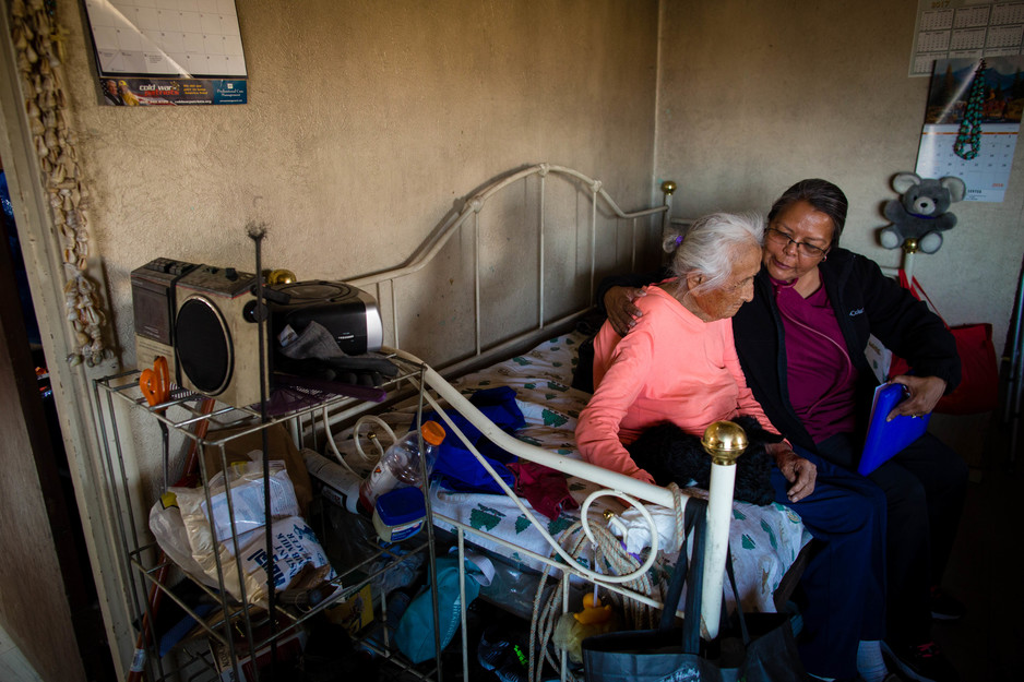 Community health representative checks on an elderly patient on Navajo Nation