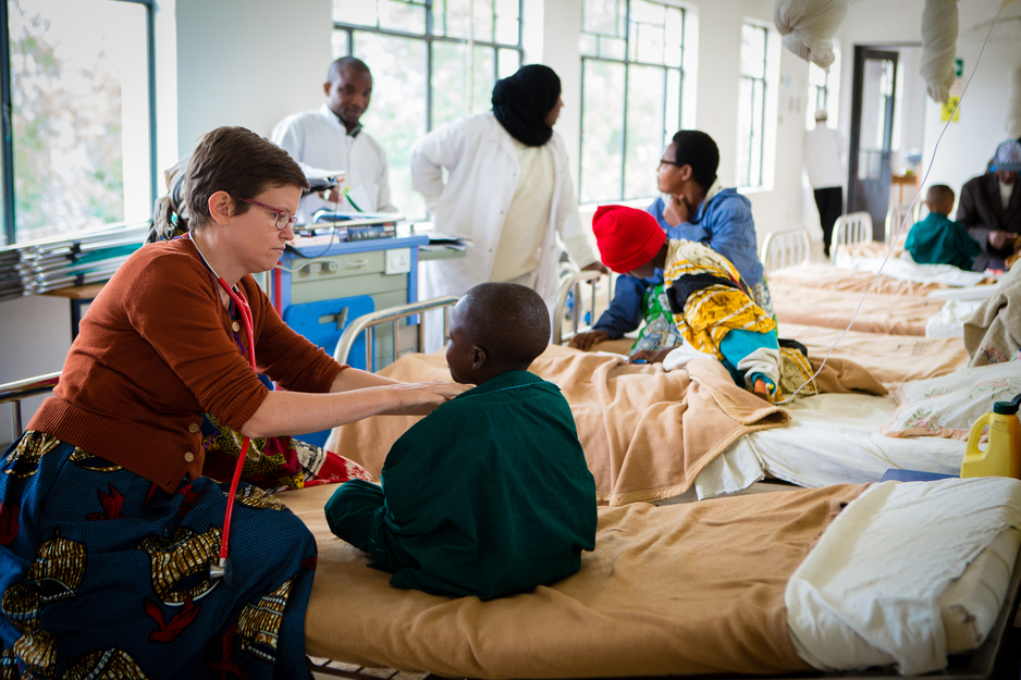 Dr. Grace Dugan checks a patient in the pediatric ward at Butaro District Hospital.