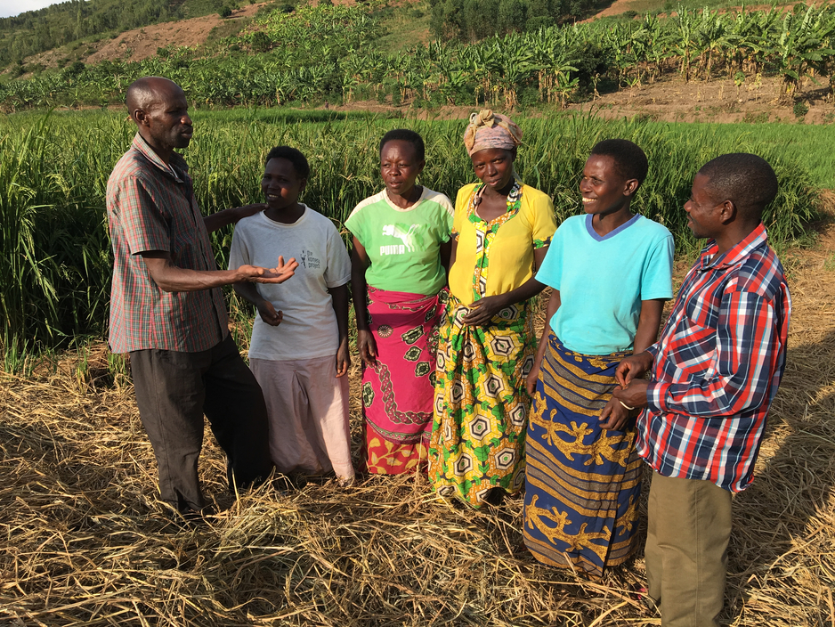 Florenti Rukiriza helps parents with rice farming to supplement their food and income