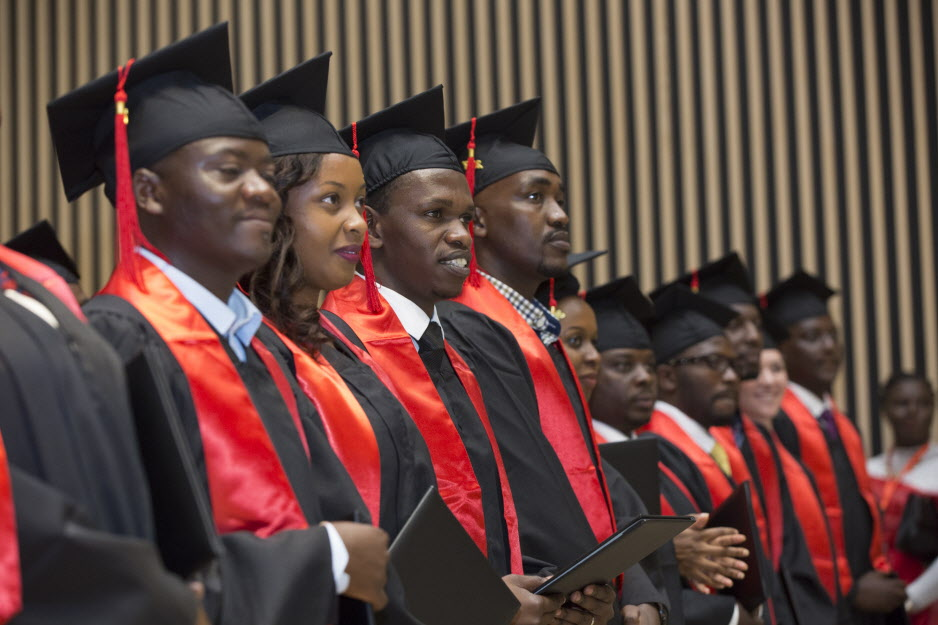 The University of Global Health Equity's first class, of 24 students, graduates in May 2017 at a ceremony in Kigali. (Photo by Zacharias Abubeker for UGHE)