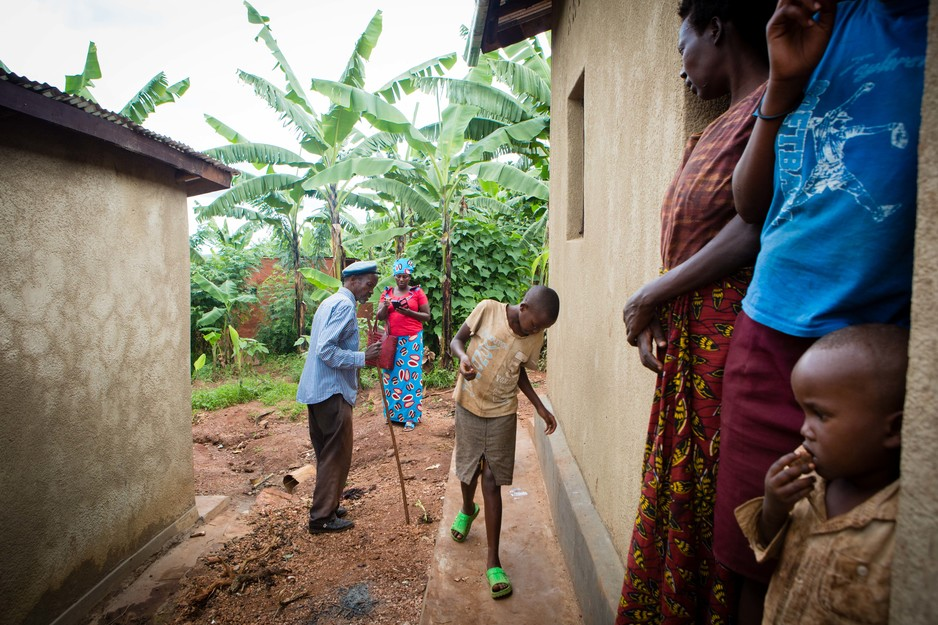 A community health worker visits a family at home in Rwanda