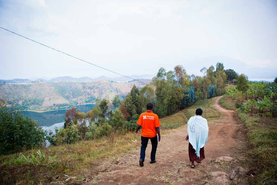 Staff for PIH in Rwanda walk to the home of a patient in Burera District, in September 2016