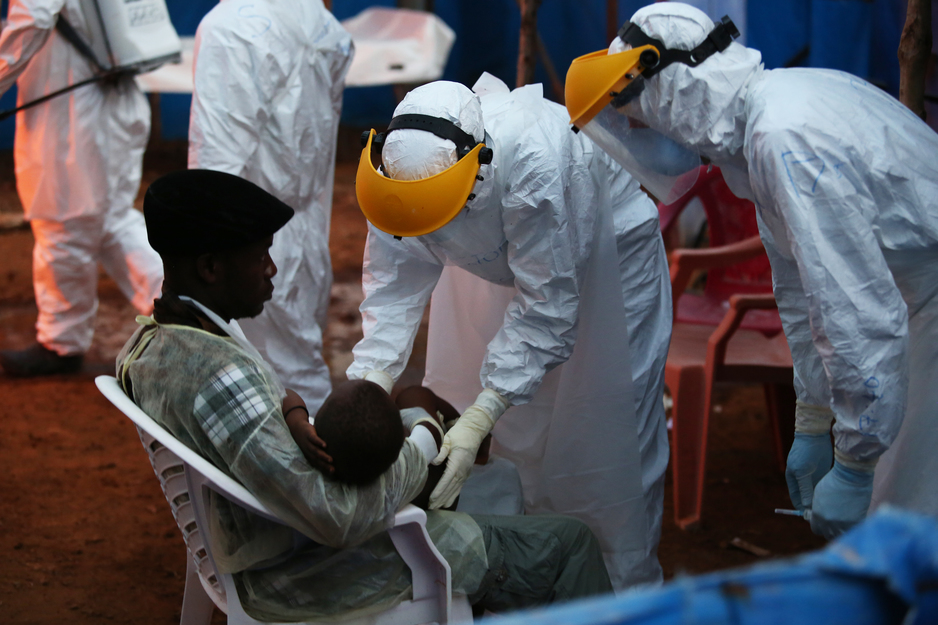 patients arrive at night to an Ebola treatment unit in Sierra Leone