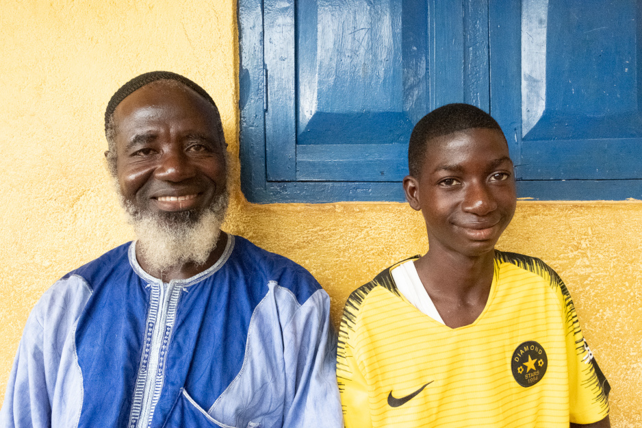 Mondeh and his father at home in Sierra Leone