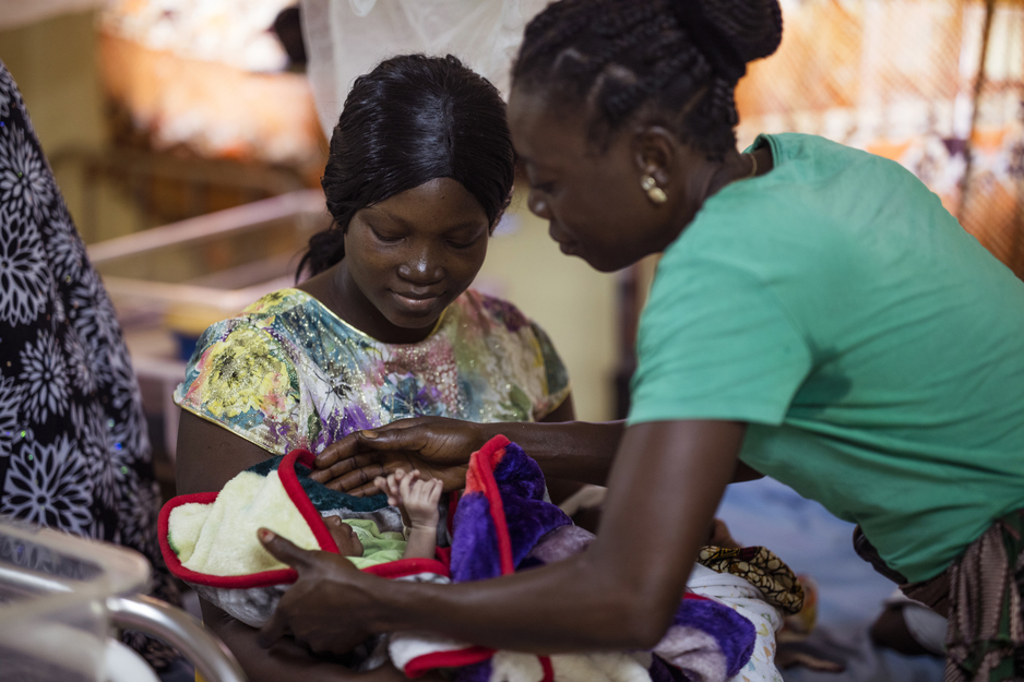new mother of twin girls receives care in Sierra Leone
