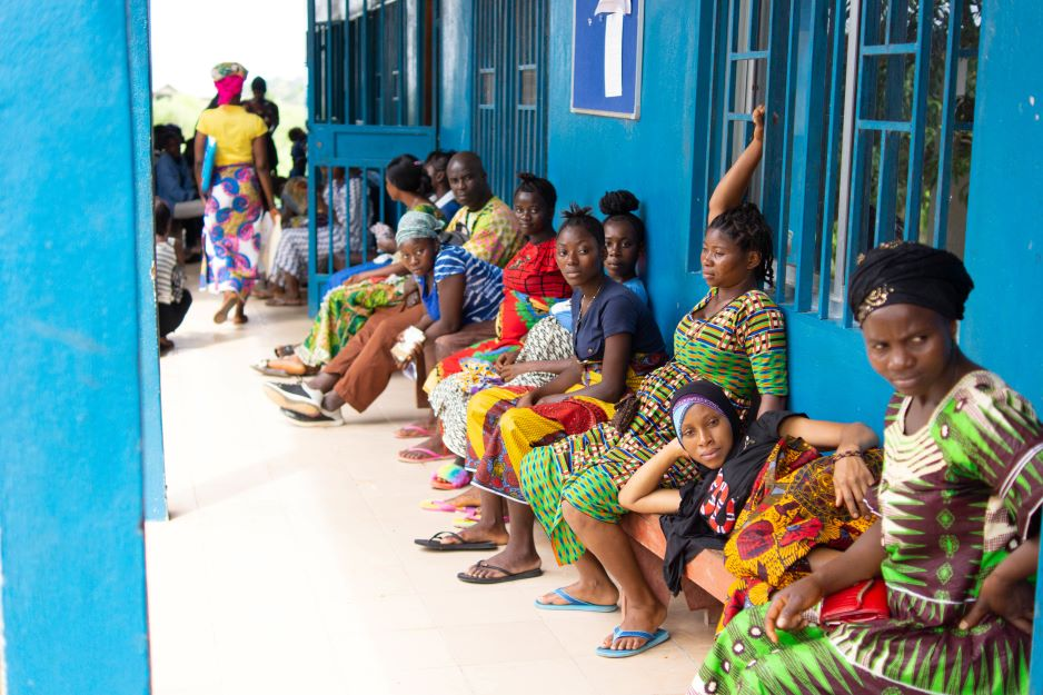 Pregnant women wait for their prenatal care appointments at Wellbody Clinic in 2018. Prenatal services at the clinic saw a drop in patients after COVID-19 was confirmed in Sierra Leone. Photo by Emma Minor / Partners In Health