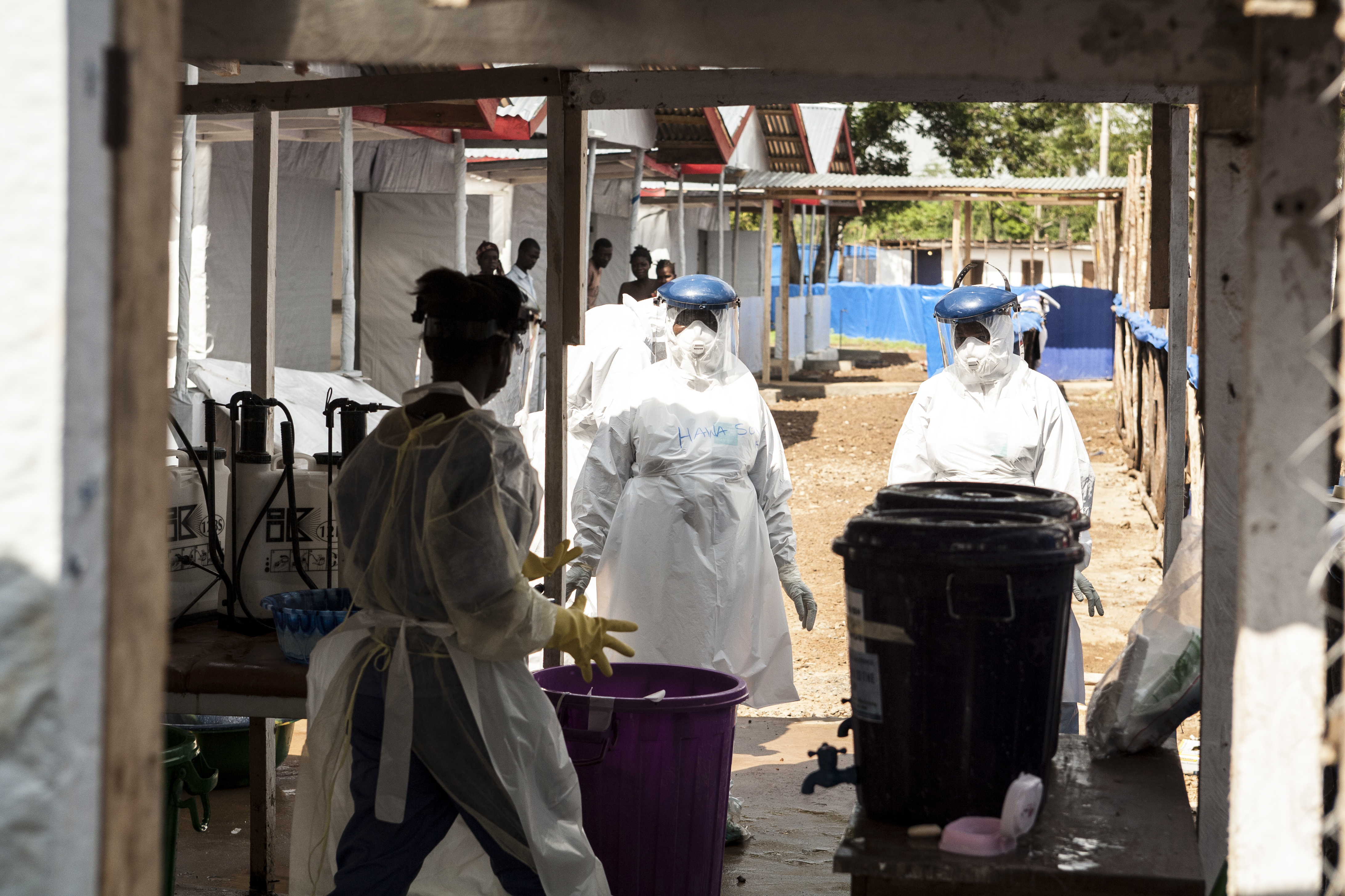 Health workers in protective garments at work in an Ebola Treatment Unit (ETU) during the 2014 crisis.