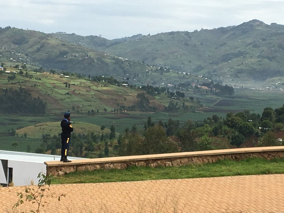 A security guard overlooks surrounding hillsides at the University of Global Health Equity in northern Rwanda