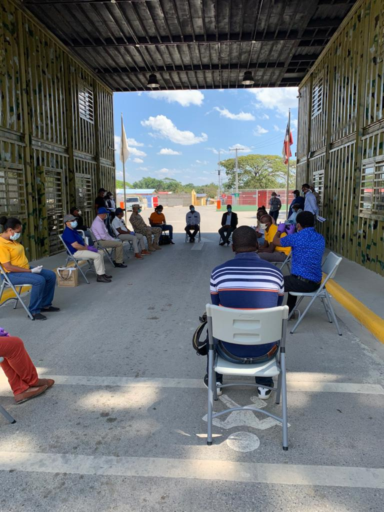 PIH staff in Haiti meet at the border with official from the Dominican Republic