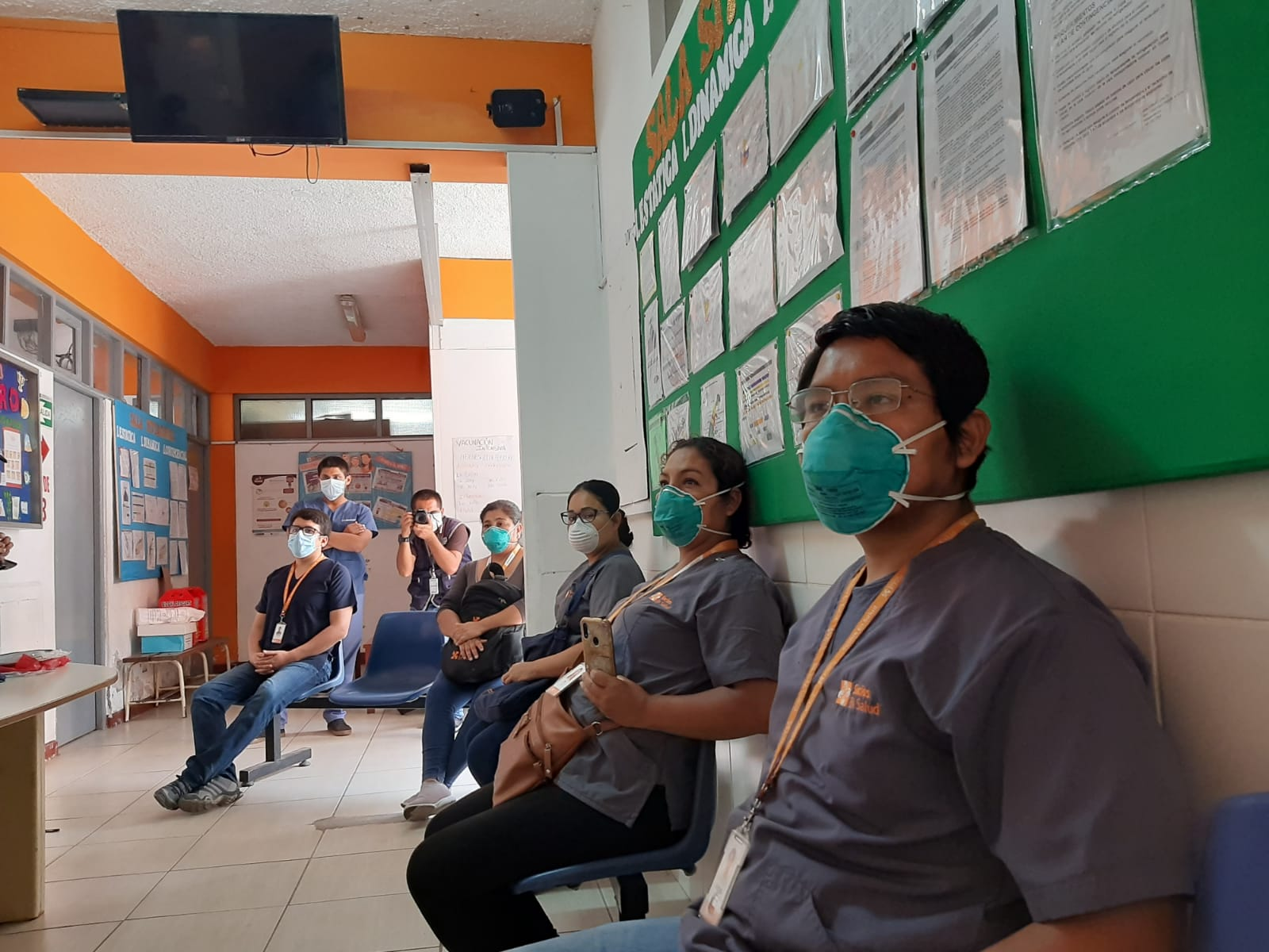 Staff gather for a training on COVID-19 rapid tests in northern Lima, Peru