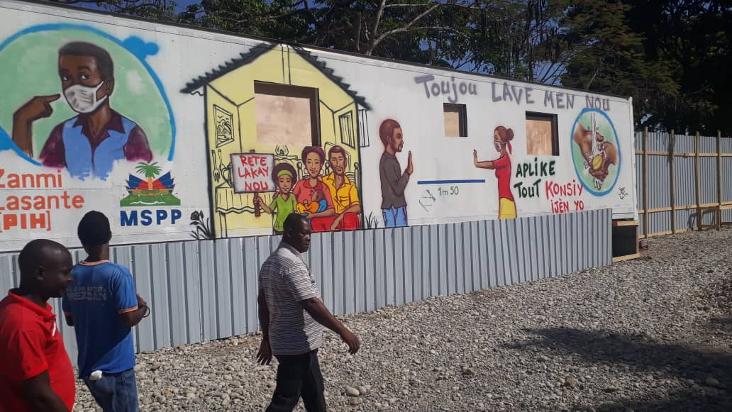 a mural in Haitian Creole educates about COVID-19 prevention