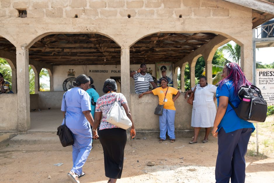 The team arrives at the community events building in Soa Chiefdom