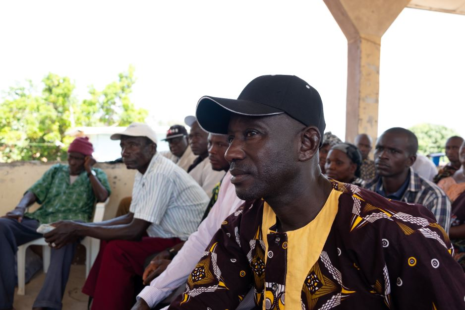 A resident of Soa Chiefdom listens to the presentation