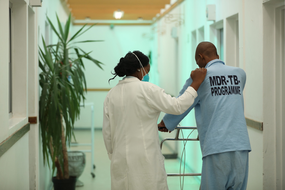 Tlotlisang Thai, registered nurse in the MDR-TB ward with patient Thoriso Daniel Limo, a 35 year-old male.