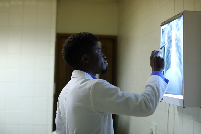 doctor reviews images of lungs from tuberculosis patient in Lesotho