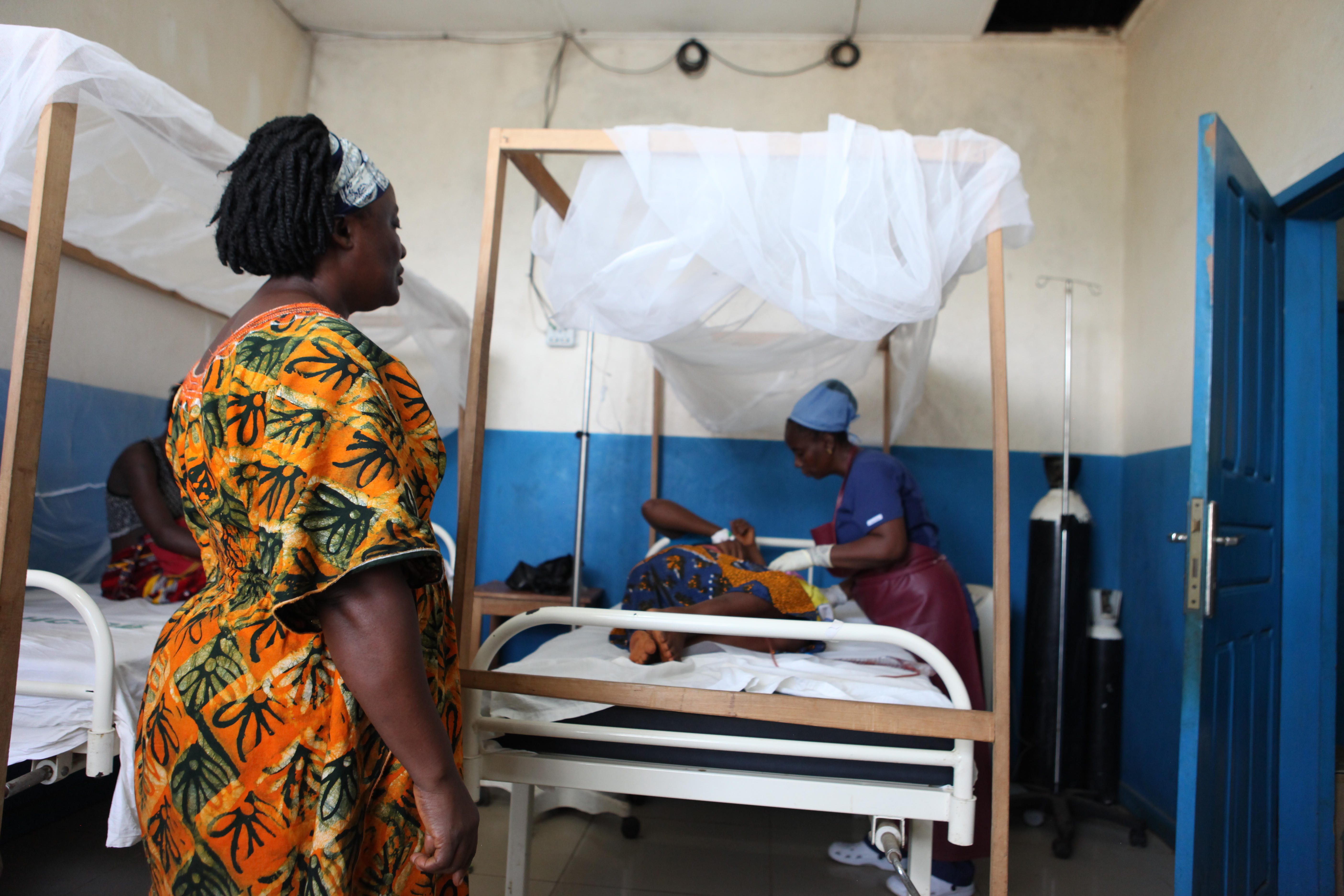 new mother settles into delivery recovery bed in Liberia