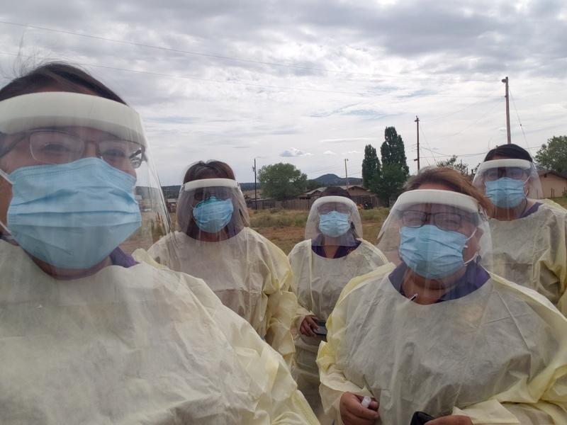 community health representatives with masks