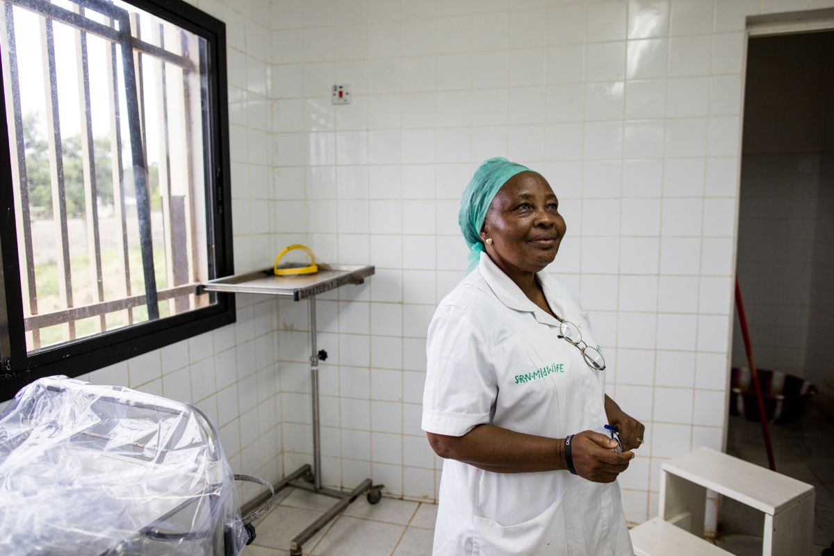 Sister Agnes Matturie, midwife in charge of managing the maternity ward at Koidu Government Hospital in Sierra Leone, stands in the ward's upgraded operating room.