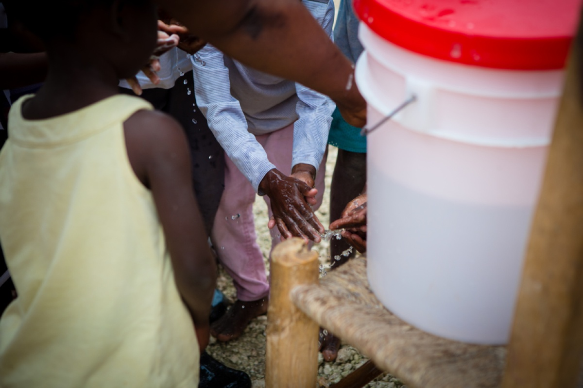 children wash hands during a cholera prevention campaign in Haiti