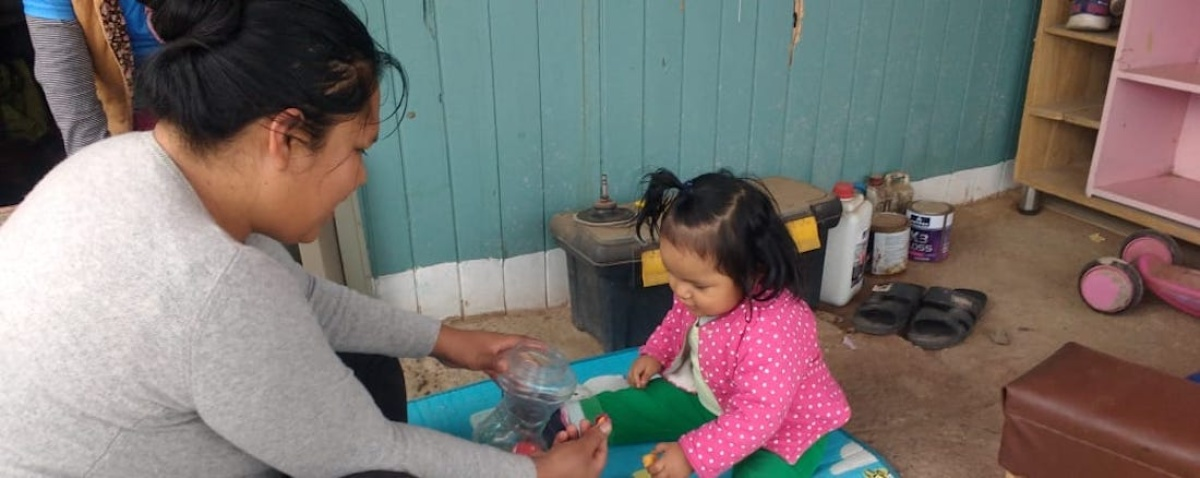 Rocío Salas and her daughter, Valentina, practice skills learned through The CASITA Project. Photo courtesy of Socios En Salud.